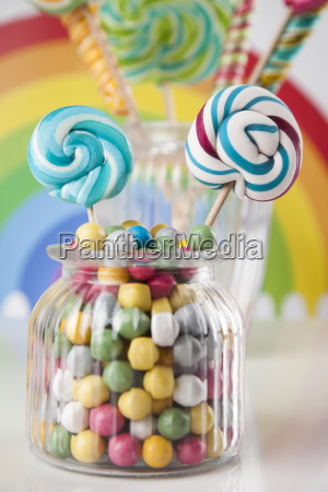 colorful, candies, in, jars, on, table - 25135266