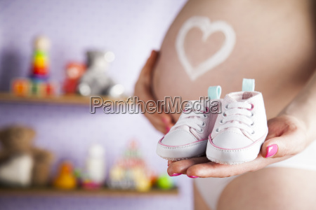 happy, pregnant, woman, , baby, shoes, in - 25135544