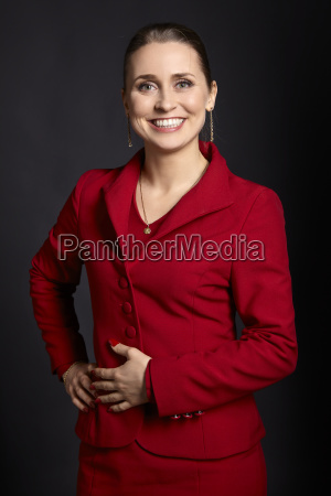 cheerful woman in a red skirt