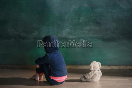 little girl with teddy bear sitting