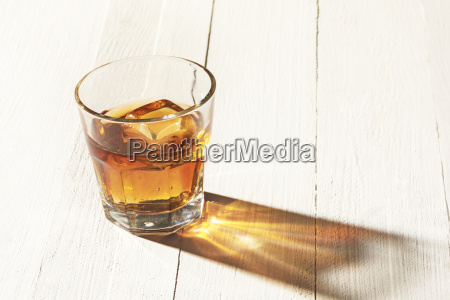 whiskey in glass ice cub served