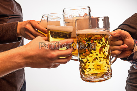 hands with mugs of beer toasting