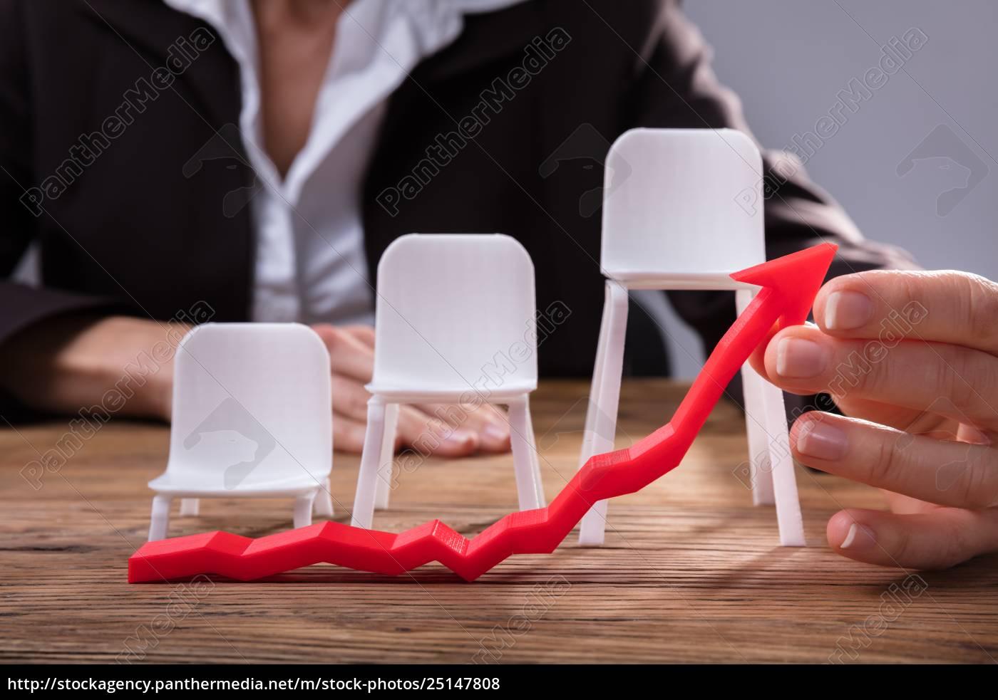 businessperson, holding, red, arrow, showing, upward - 25147808