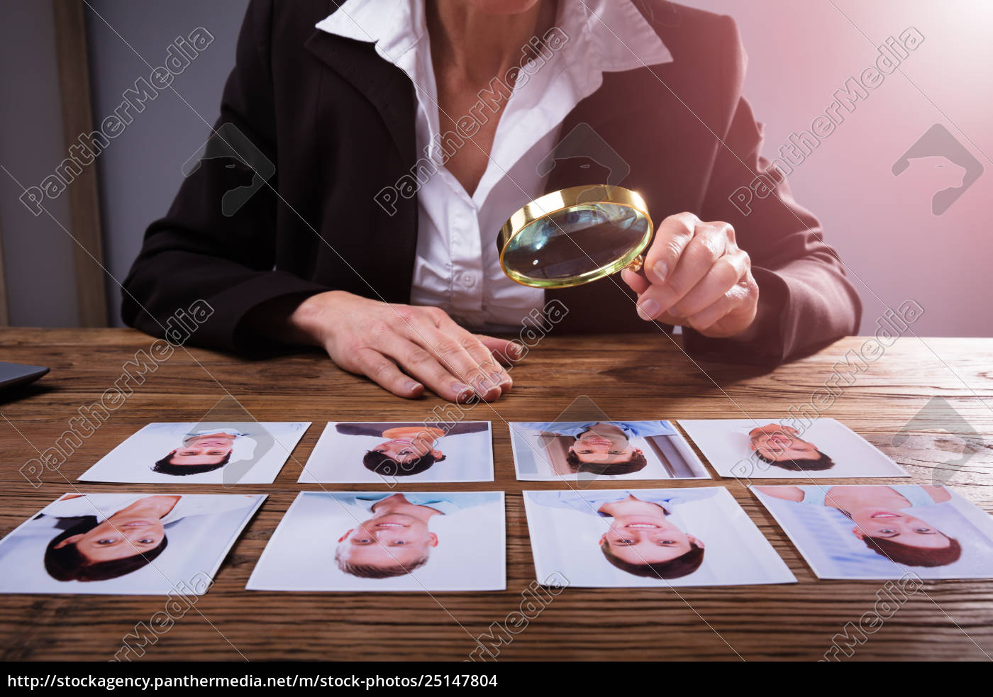 businessperson, looking, at, candidate's, photograph - 25147804