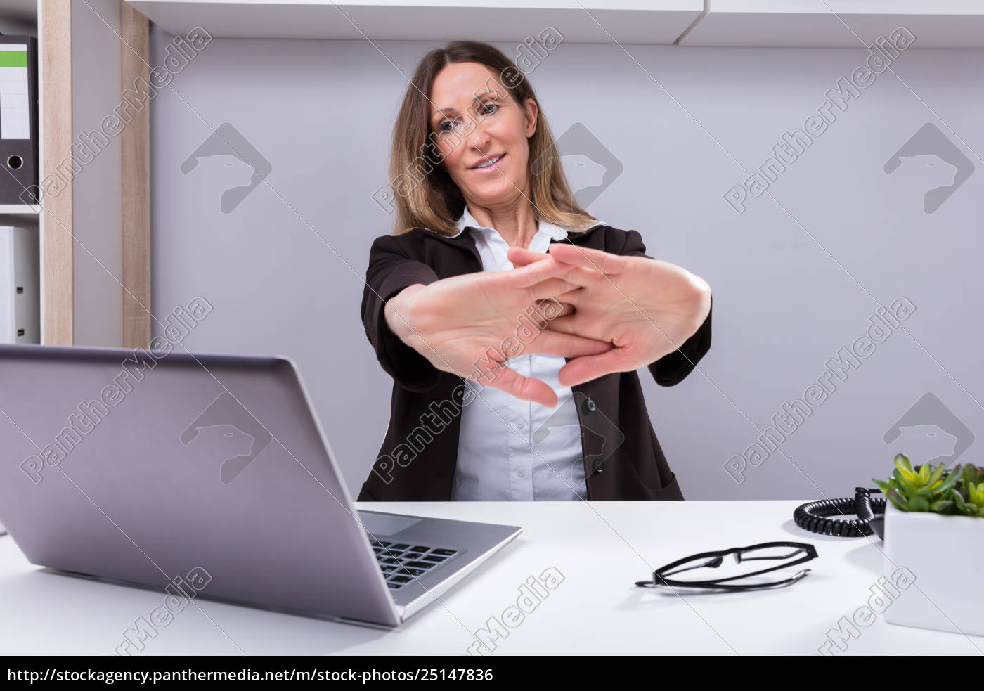 businesswoman, stretching, her, arms - 25147836