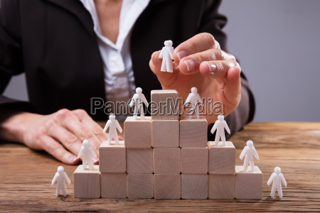 close-up, of, a, businessperson, placing, human - 25147806