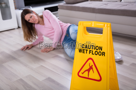 woman, falling, near, caution, sign, at - 25147778