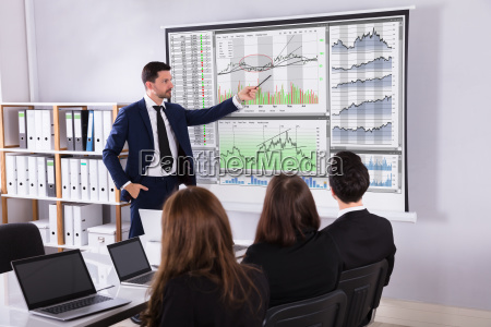 stock market broker giving presentation to