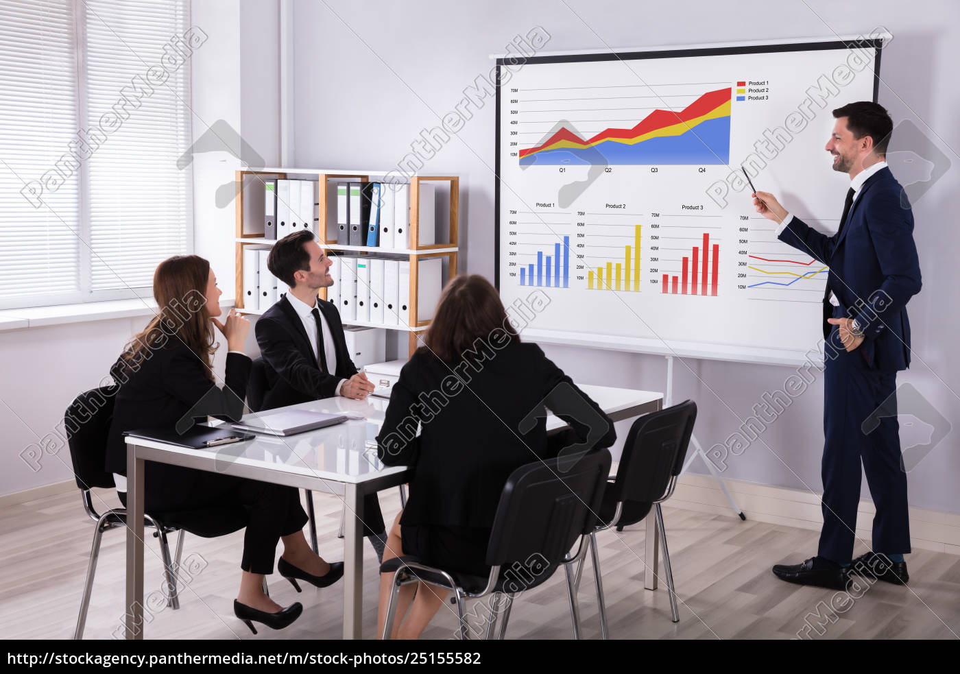 businessman, explaining, graphs, to, his, colleagues - 25155582