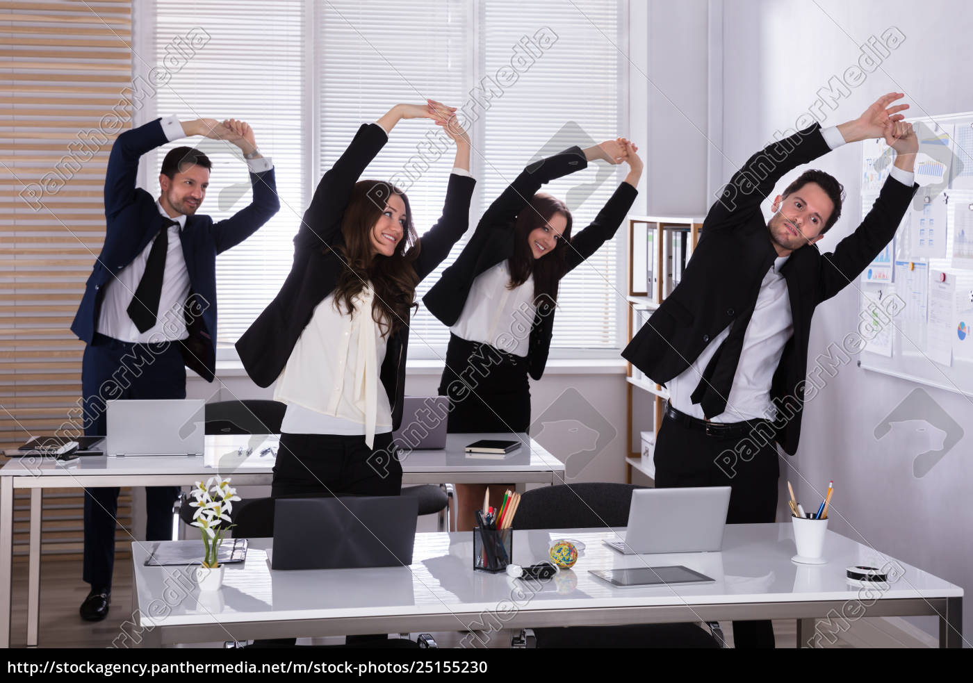 businesspeople, doing, exercise, behind, desk - 25155230