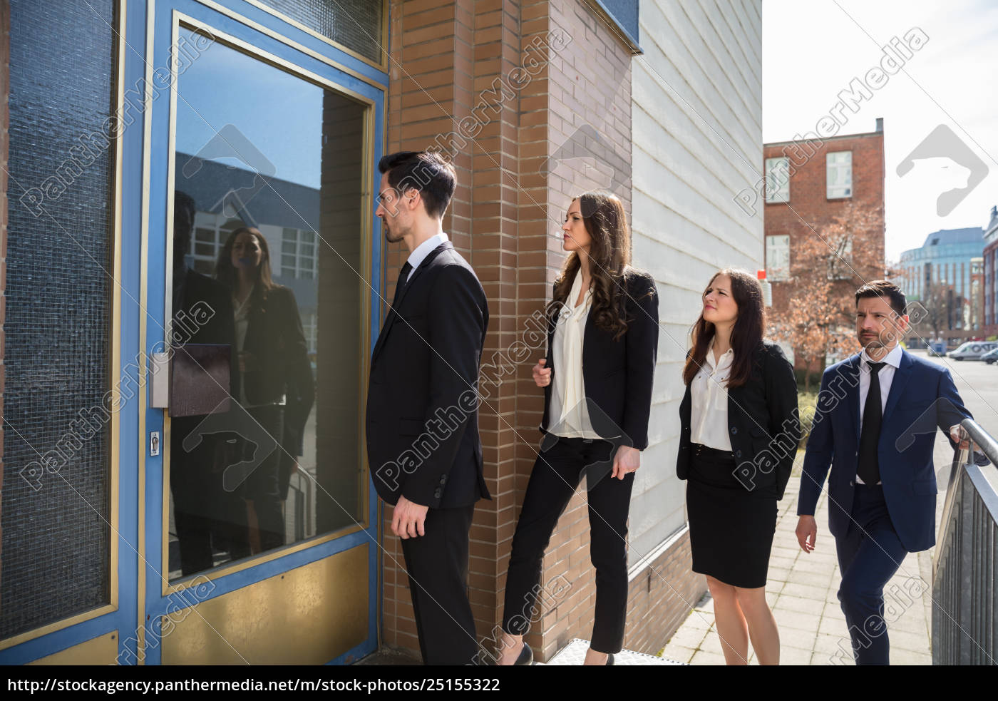 businesspeople, standing, outside, office, building - 25155322