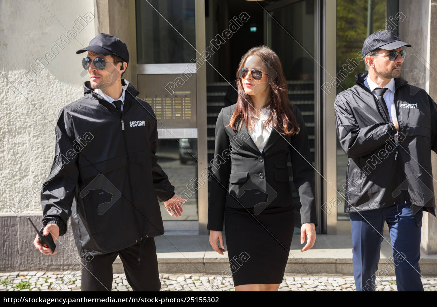 businesswoman, stepping, out, from, office, building - 25155302