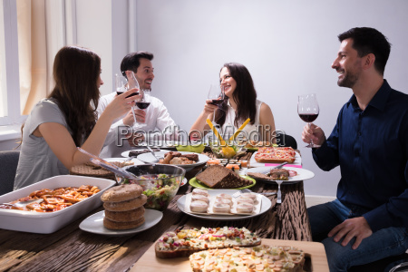 friends, enjoying, food, with, glass, of - 25155094
