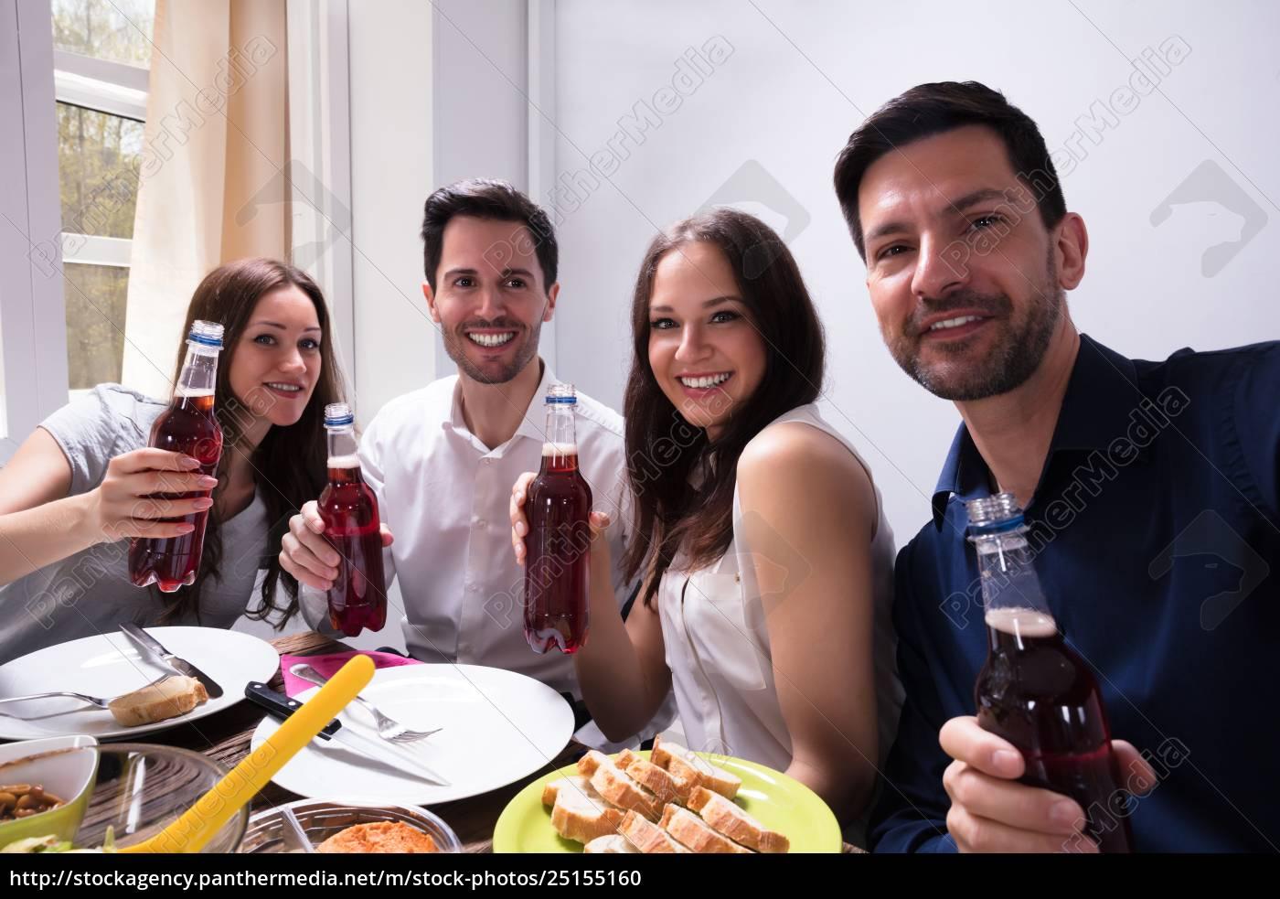 friends, holding, bottle, of, beer - 25155160