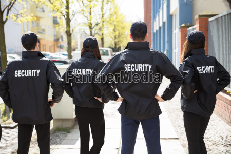 rear, view, of, security, guards, standing - 25155288