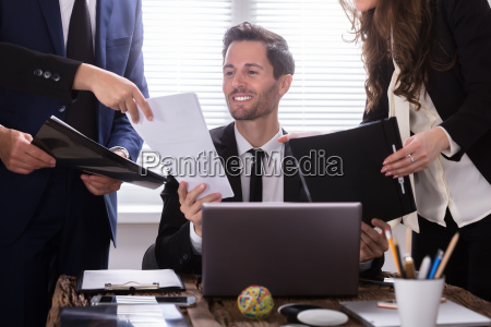 young, businessman, looking, at, document - 25155462