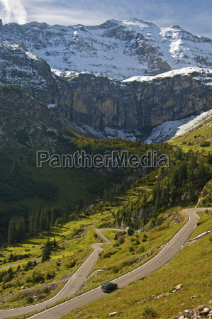 alpine landscape with mountain road to