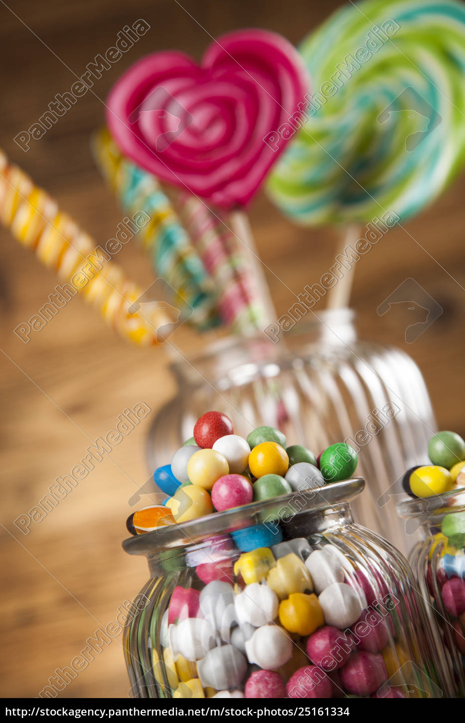 colorful, candies, in, jars, on, table - 25161334