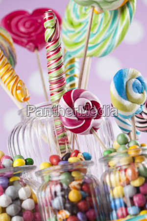 colorful, candies, in, jars, on, table - 25161758