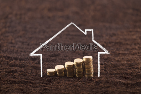 drawing house with growing coins on