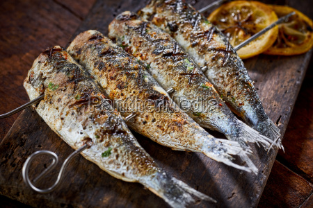 four spicy grilled fresh fish on