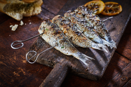 fish, on, skewers, served, on, rustic - 25177576