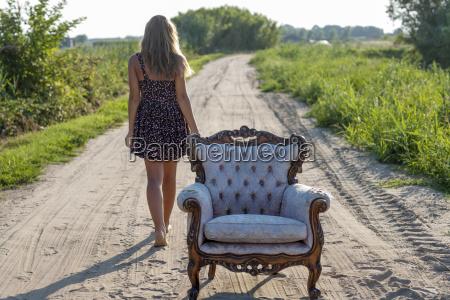 woman armchair walk go going walking
