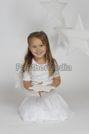 child girl as angel with stars