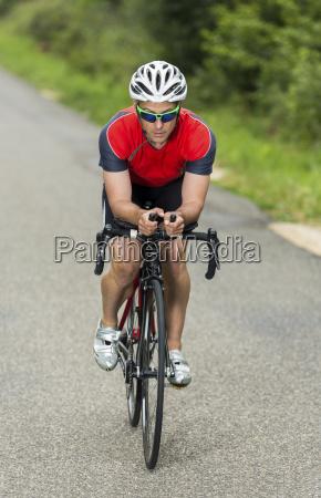 triathlete on the bike male 45