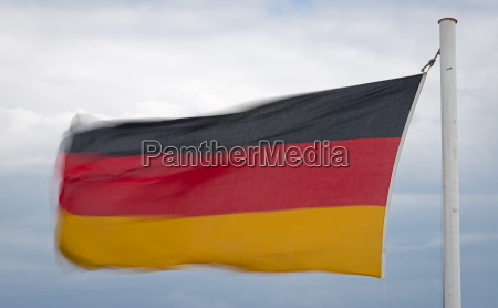 german flag flutters in the wind