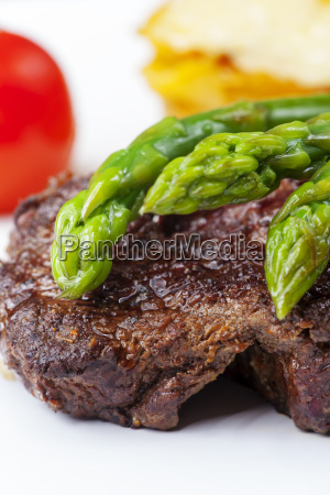 beef steak and green asparagus on