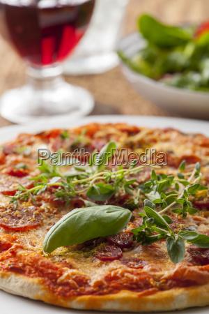 fresh herbs on a pizza