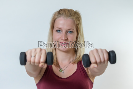 young woman working out with weights