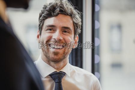 headshot of a mid adult businessman