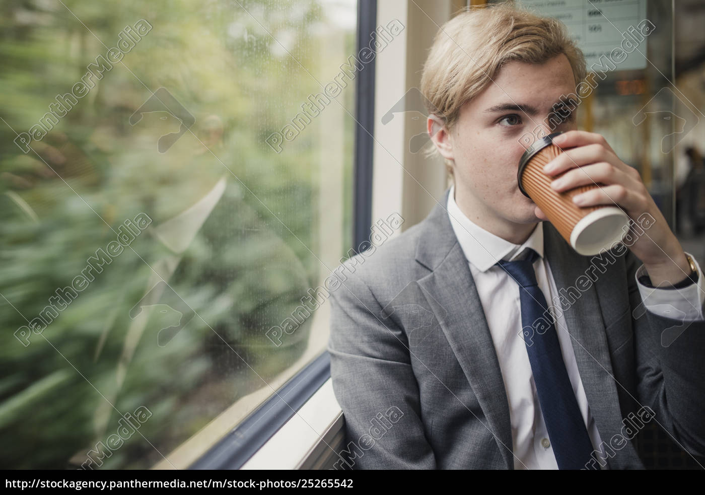 businessman, drinking, coffee, on, the, train - 25265542