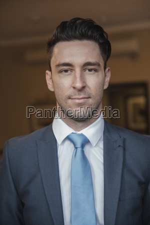 headshot of a young businessman