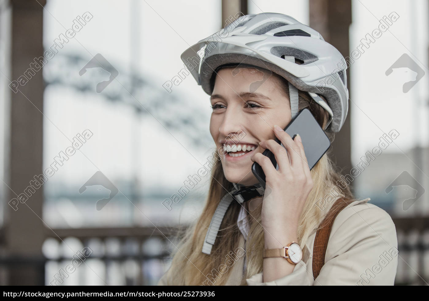 businesswoman, making, a, call, while, cycling - 25273936