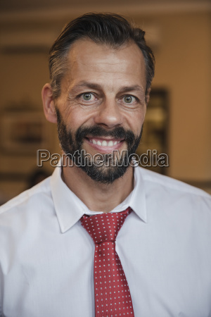 confident businessman getting his portrait taken