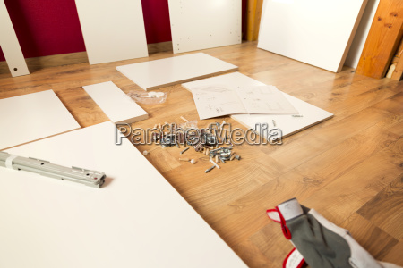 assembling new wooden bed by hand