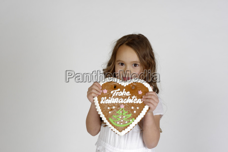 naughty child girl with gingerbread heart