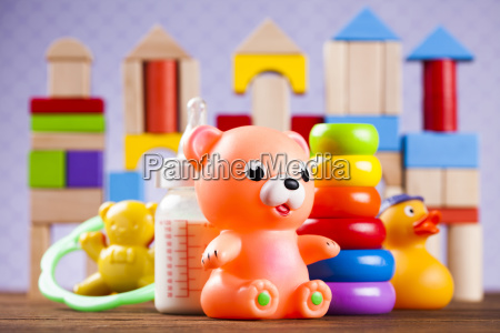 stuffed, baby, toys, on, wooden, background - 25318678