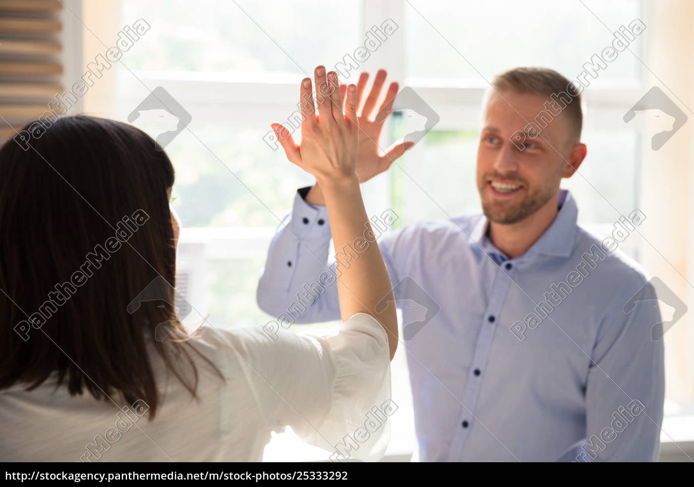 businessman, giving, high, five, to, his - 25333292
