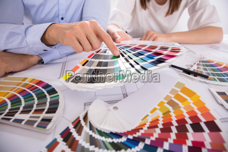 close-up, of, two, architect, holding, colorful - 25333766