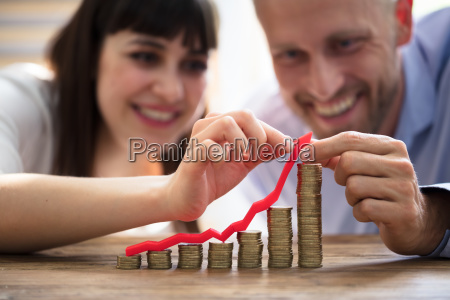 couple, protecting, increasing, stacked, coins - 25333584