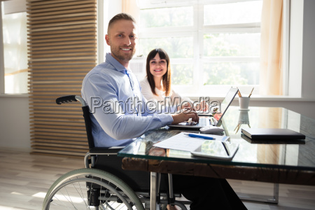 smiling, disabled, businessman, working, on, laptop - 25333310