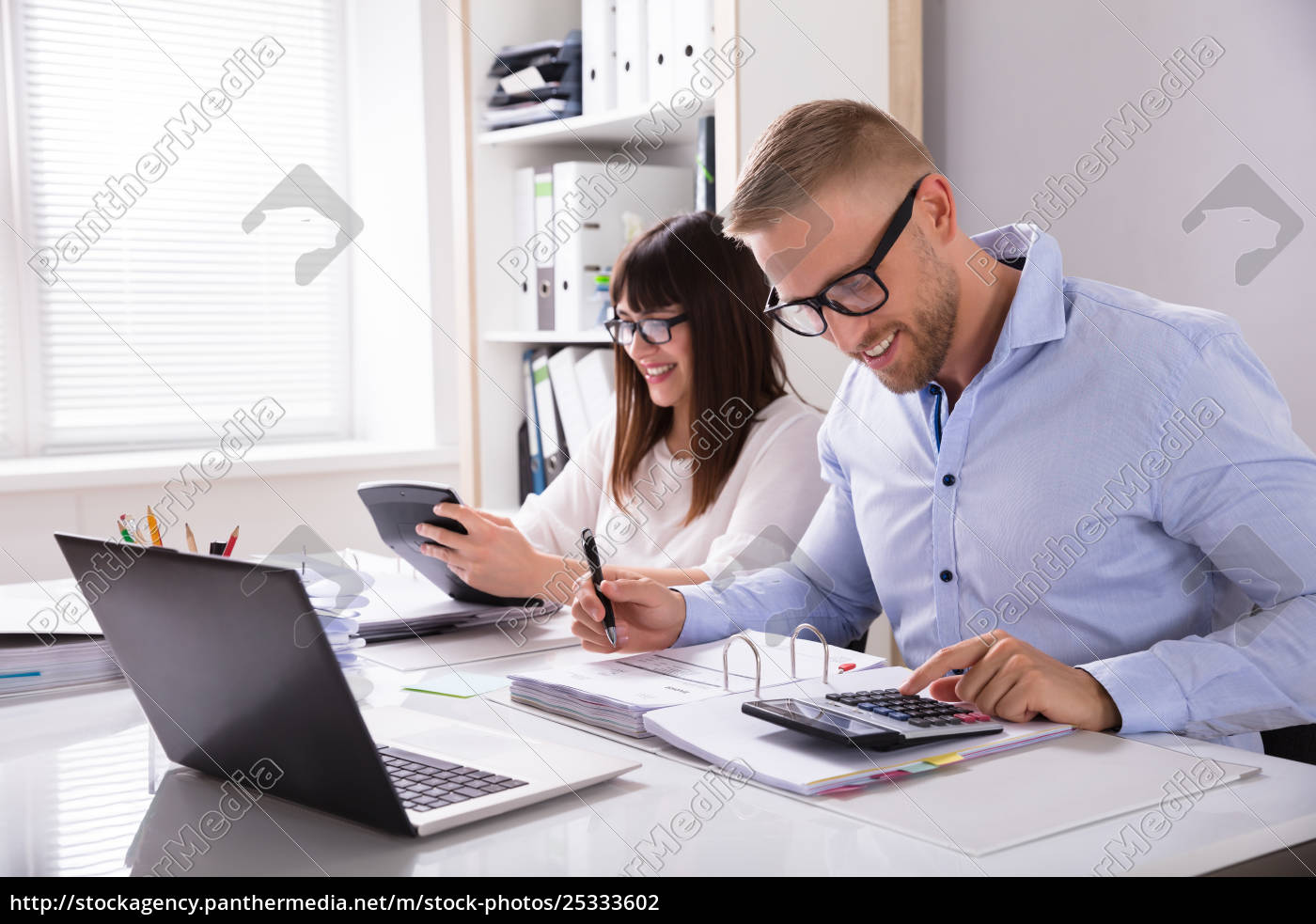 two, businesspeople, calculating, invoice - 25333602