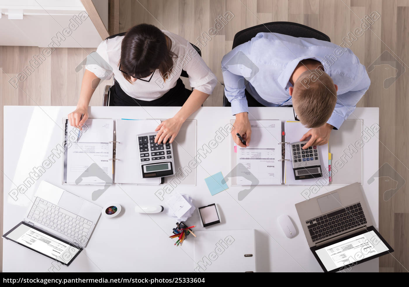 two, businesspeople, calculating, invoice - 25333604