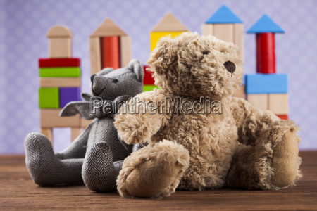 cute, teddy, bears, on, wooden, background - 25334554