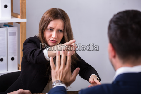businesswoman, scolding, her, colleague - 25335940