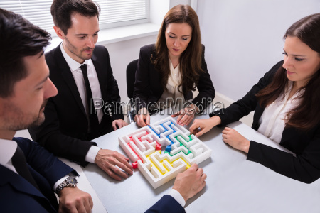 businesspeople, holding, multi, colored, arrow, solving - 25336148